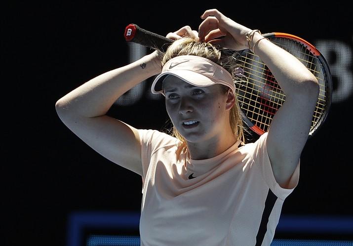 Ukraine's Elina Svitolina adjusts her hair during her third round match against compatriot Marta Kostyuk at the Australian Open tennis championships in Melbourne, Australia, Friday, Jan. 19, 2018. (Dita Alangkara/AP)
