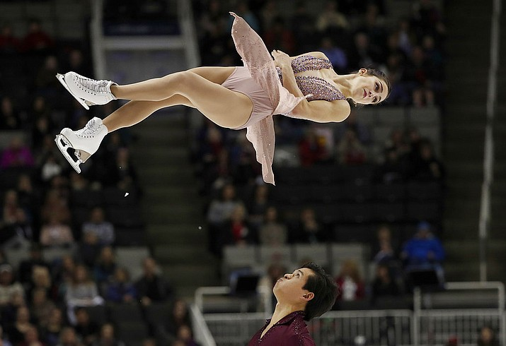 In this photo, Marissa Castelli, top, and Mervin Tran perform during the pairs free skate event at the U.S. Figure Skating Championships, in San Jose, Calif. San Francisco police have recovered two pricey costumes and a pair of ice skates belonging to U.S. Olympic figure skater Marissa Castelli.(AP Photo/Tony Avelar, File)