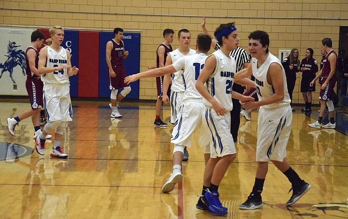 Camp Verde celebrates their 55-52 win over Northland Prep on Tuesday at home. (VVN/James Kelley)