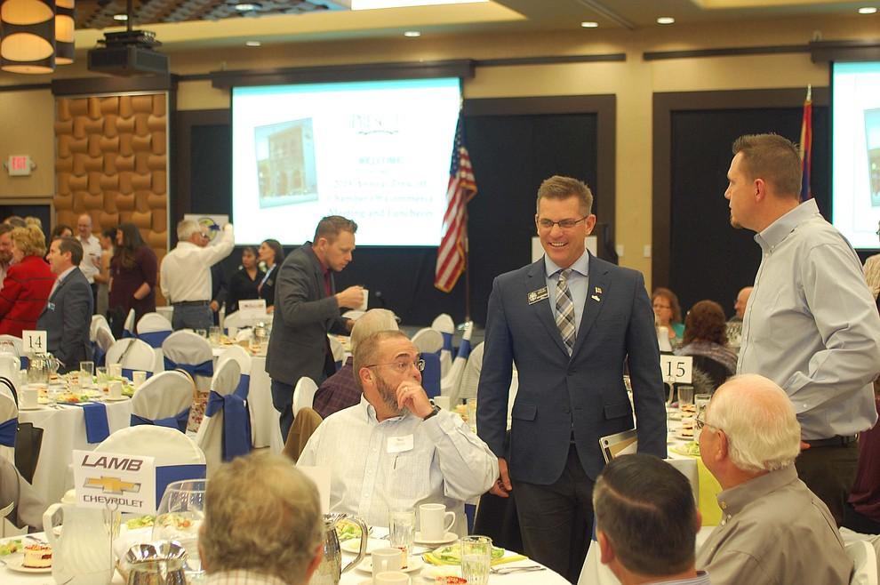 Prescott Mayor Greg Mengarelli talks with attendees of the Prescott Chamber of Commerce Annual Meeting at the Prescott Resort on Thursday, Jan. 18. (Tim Wiederaenders/Courier)