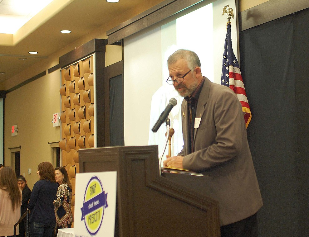 Sanford Cohen, 2017 chairman of the board, speaks at the Prescott Chamber of Commerce Annual Meeting at the Prescott Resort on Thursday, Jan. 18, about progress in the past year. (Tim Wiederaenders/Courier)