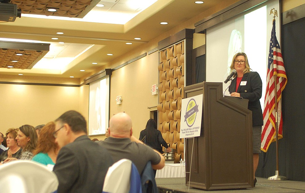 Margo Christensen speaks to the crowd at the Prescott Chamber of Commerce Annual Meeting at the Prescott Resort on Thursday, Jan. 18. She is the 2018 chairman of the chamber's board. (Tim Wiederaenders/Courier)