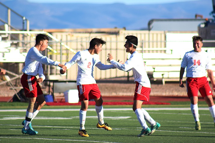 Mingus Union celebrates sophomore Eduardo Lazar's game winning goal against Prescott on Saturday at home. (VVN/James Kelley)
