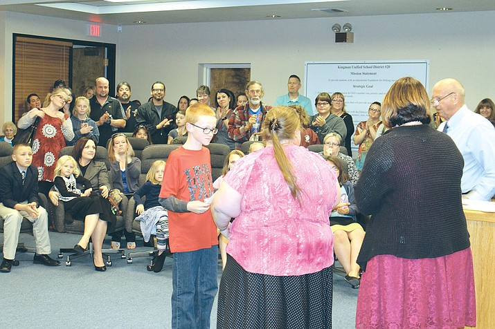 Brandon Smith receives a certificate for his perfect math score on the AzMerit test in this Daily Miner file photo. Arizona schools ranked 45th among the 50 states.