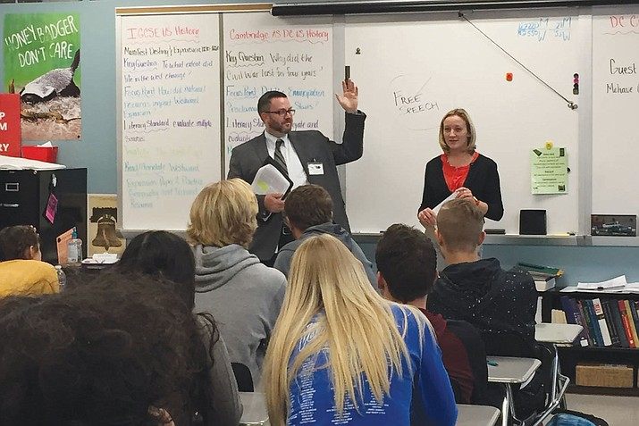 Mohave County public defenders Nathan Best and Karolina Czaplinska address Cheryl Massey's civics class at Lee Williams High School as part of the Marshall-Brennan Literacy Project.