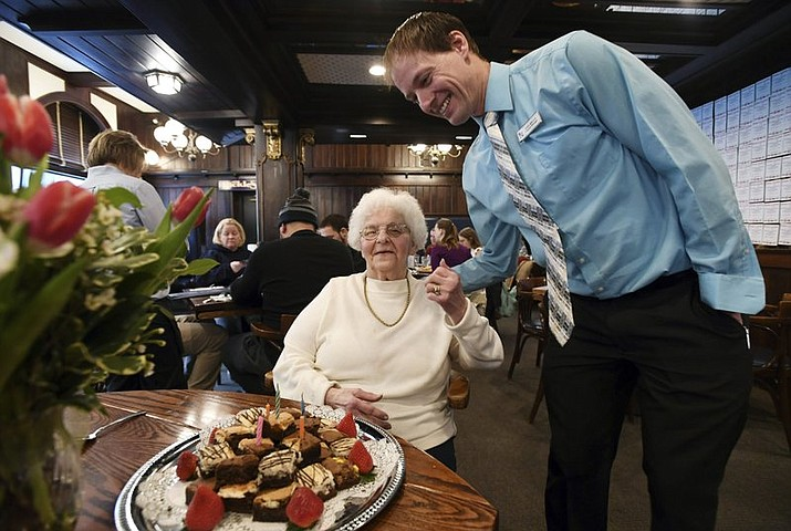Emma Gunsallus chats with General Manager John Briggs during her last day on the job Tuesday, Jan. 16, 2018 at the Corner Room in State College. Gunsallus has been a waitress at the restaurant for 61 years. (Phoebe Sheehan/Centre Daily Times via AP)