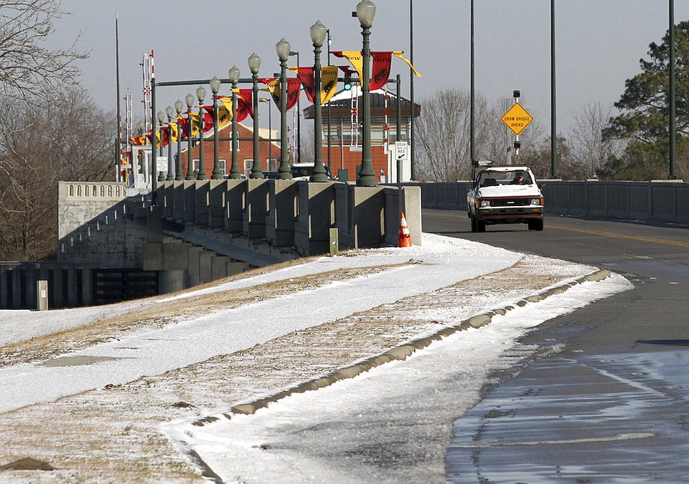 Traffic moves across the Alfred A. Cunningham Bridge in New Bern, N.C., Thursday, Jan. 18, 2018, after a winter weather system swept across the region overnight. (Gray Whitley/Sun Journal via AP)