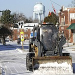 City of New Bern Public Works staff clear streets of ice and snow in downtown New Bern, N.C., Thursday, Jan. 18, 2018, after a brief winter front brought frigid weather across the region overnight. (Gray Whitley /Sun Journal via AP)