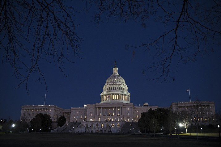 With no apparent indications of a breakthrough in the Senate to avoid a government shutdown, the Capitol is illuminated in Washington, Friday evening, Jan. 19, 2018.