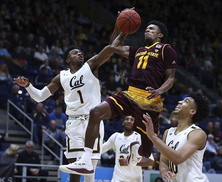 Arizona State's Shannon Evans II (11) shoots between California's Darius McNeill, left, and Justice Sueing during the second half of an NCAA college basketball game Saturday, Jan. 20, 2018, in Berkeley, Calif.