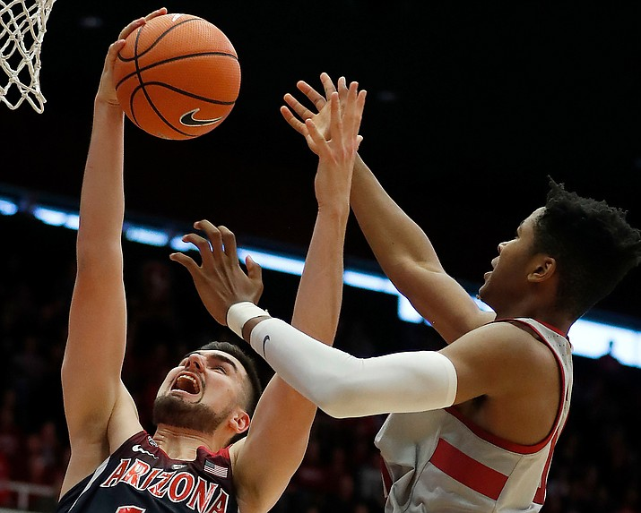 Arizona center Dusan Ristic (14) battles for a rebound against Stanford forward Kezie Okpala (0) during the second half of an NCAA college basketball game Saturday, Jan. 20, 2018, in Stanford, Calif. Arizona won 73-71. (Tony Avelar/AP)