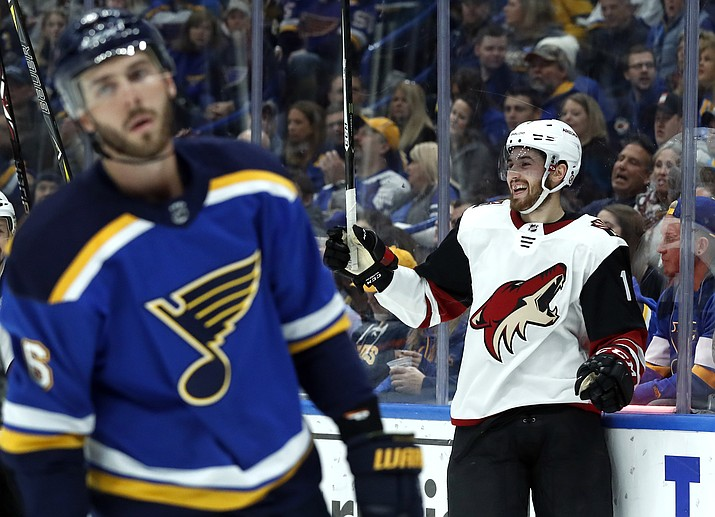 Arizona Coyotes' Brendan Perlini, right, celebrates after scoring as St. Louis Blues' Joel Edmundson, left, skates past during the first period of an NHL hockey game Saturday, Jan. 20, 2018, in St. Louis. (Jeff Roberson/AP)