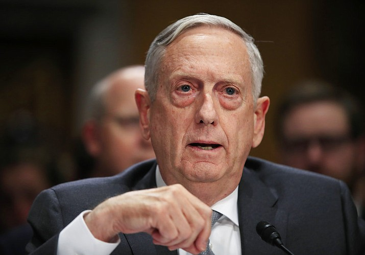 "In this Oct. 30, 2017, file photo, Secretary of Defense Jim Mattis, testifies during a Senate Foreign Relations Committee hearing on ""The Authorizations for the Use of Military Force: Administration Perspective"" on Capitol Hill in Washington. A half century after the Tet Offensive punctured American hopes for victory in Vietnam, Mattis is visiting the former enemy to promote closer ties. Mattis will be in Vietnam just days before the 50th anniversary of the Communist offensive on Jan. 30-31, 1968, in which North Vietnam attacked an array of key objectives in the South, including the city of Hue. (AP Photo/Manuel Balce Ceneta, File)"