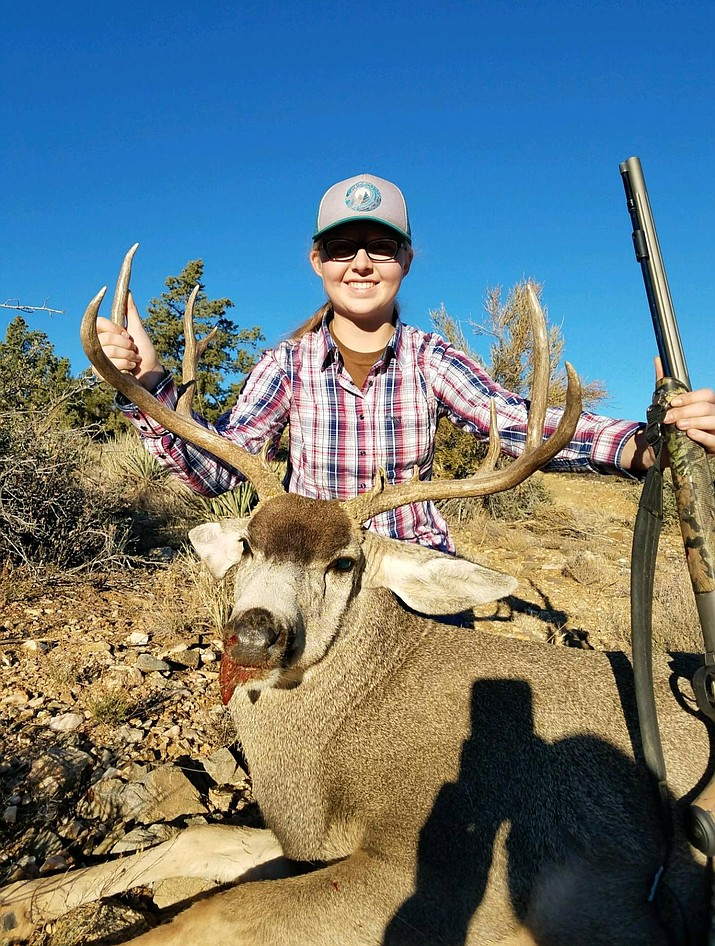 13-year-old Kinsley Rupe shows the 4x3 buck that she took on a recent juniors only muzzleloader hunt in Unit 16A, the Hualapai Mountains.