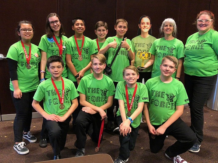Students on The Force team from Kingman Academy Middle School participated in the First Lego League state championship tournament Jan. 14 at Arizona State University. The team won a trophy for robot design presentation. (COURTESY PHOTO)