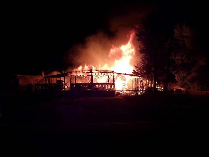 An unoccupied double-wide mobile home in the Butler area goes up in flames Monday morning. (Courtesy of NACFD)