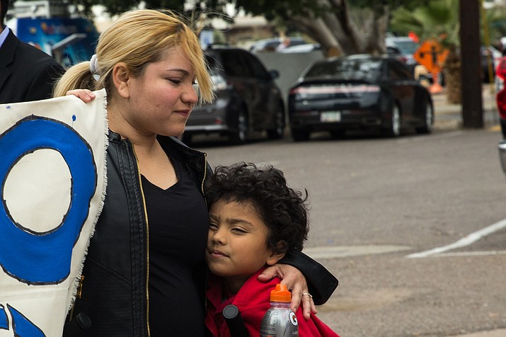 Eva Pineda attended the DACA protest outside of the Arizona Democratic Party headquarters in Phoenix on Tuesday with her children.