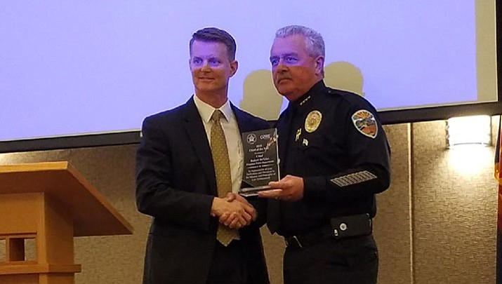 Kingman Police Chief Bob DeVries, right, accepts an award from Marana Police Chief Terry Rozema as 2018 Police Chief of the Year from the Arizona Association of Police Chiefs.