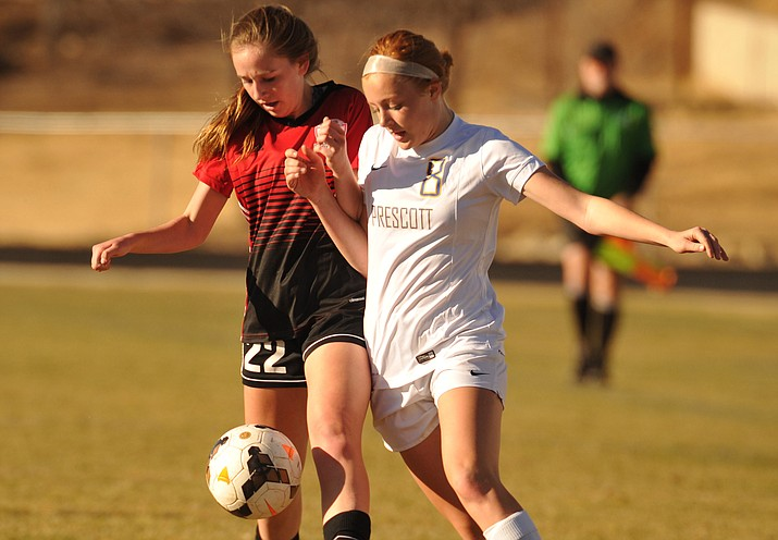 Prescott's Erika Smith (8) battles with Hayley Denman (22) as the Badgers hosted cross-town rival Bradshaw Mountain on Tuesday, Jan. 23, 2018, in Prescott. (Les Stukenberg/Courier)