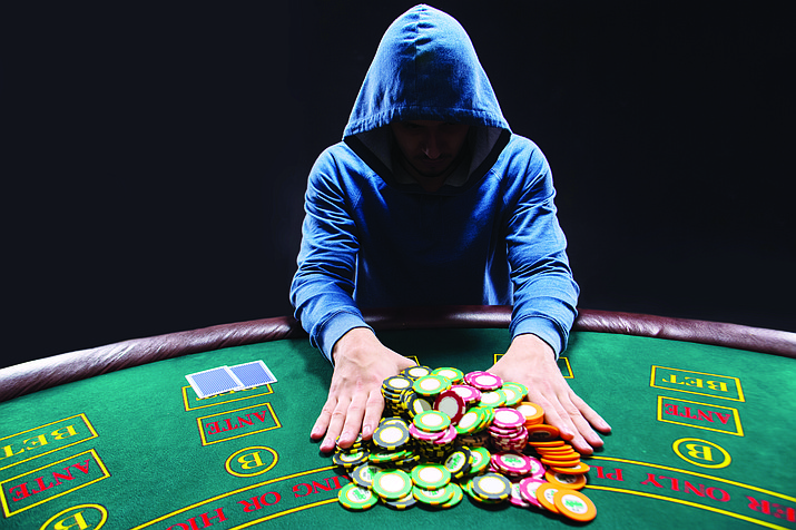 When those with gambling problems reach a benchmark amount of time without gambling, they receive chips to remind them of their progress. The chips are in the form of key chains so the recipient sees it often. (Max Efrein/Courier)