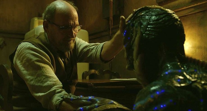 """This image released by Fox Searchlight Pictures shows Richard Jenkins, left, and Doug Jones in a scene from the film """"The Shape of Water."""" Jenkins was nominated for an Oscar for best supporting actor on Tuesday, Jan. 23, 2018. The 90th Oscars will air live on ABC on Sunday, March 4. (Fox Searchlight Pictures)"""