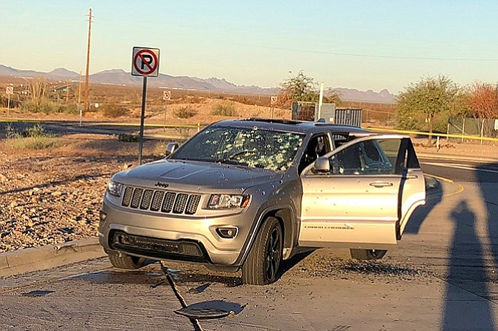 A bullet riddled vehicle after a suspect in a Phoenix homicide was involved in a shootout with law enforcement officers at a rest area Nov. 28, 2016 in western Arizona. (Arizona Department of Public Safety)