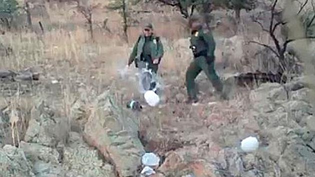 This Jan. 10, 2011, image taken from video provided by 'No More Deaths' shows Border Patrol agents kicking over water bottles left for those crossing into the U.S. illegally in Arizona. The video, posted to Twitter, can be seen in the story below. (Photo from No More Deaths)