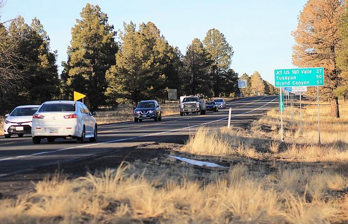 Vehicles stream down from the Grand Canyon on State Route 64. Local residents share the road with many of the 6 million yearly visitors to the Grand Canyon that travel the highway. The highway has seen several serious accidents in the past year.