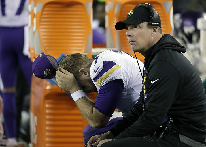 Minnesota Vikings quarterback Case Keenum, left, reacts on the bench beside offensive coordinator Pat Shurmur during the second half of the NFC championship game against the Philadelphia Eagles, in Philadelphia. (Matt Slocum/AP, File)