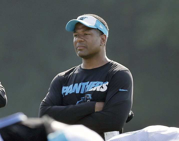 In this Aug. 3, 2015, file photo, Steve Wilks watches players warm up during training Carolina Panthers camp in Spartanburg, S.C. The Arizona Cardinals announced Monday, Jan. 22, 2018, they were hiring Wilks as the team's next head coach. (Chuck Burton/AP, File)