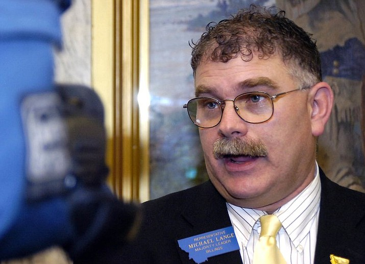 In this April 26, 2007, file photo, Montana House Majority Leader Rep. Michael Lange, R-Billings, speaks during a news conference in Helena, Mont. Prosecutors are seeking 28 years in prison for the former Republican lawmaker after he pleaded guilty to charges of distributing large volumes of methamphetamine in the Billings area. (George Lane /Independent Record via AP, File)
