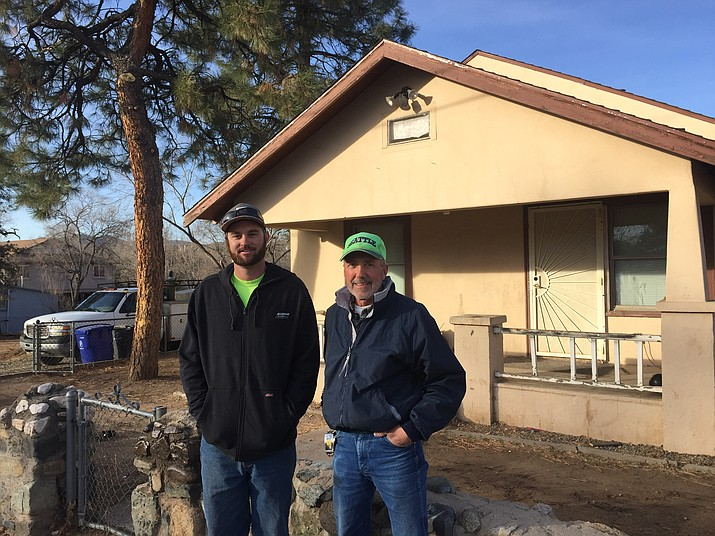 Local businessmen Garrett Denny, left, and Vince Fornara, right, of Vibrant Building Solutions are working to renovate a 1940s-era Lincoln Avenue home. They plan to move five existing buildings to create an in-fill residential project. (Cindy Barks/Courier).