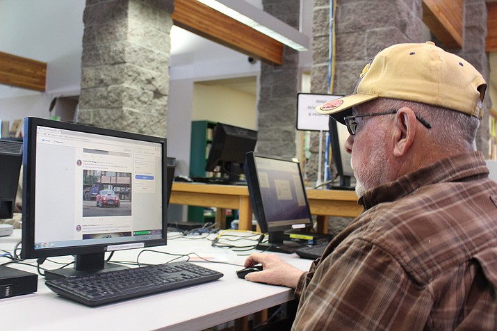 Patrick Cassidy uses a computer at Mohave County Library-Kingman to research replica car kits. Today's libraries offer a lot more to do besides checking out books.