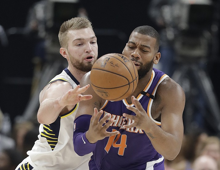 Phoenix Suns' Greg Monroe is defended by Indiana Pacers' Domantas Sabonis in the first half Wednesday, Jan. 24, 2018, in Indianapolis. (Darron Cummings/AP)
