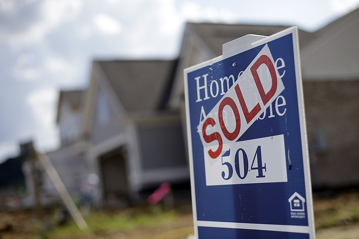 This June 4, 2015, file photo, shows a sign indicating a site has been sold in a new home development in Nashville, Tenn. If you're in a committed relationship but nuptials are on the back burner, your dream of buying a home doesn't have to be. (Mark Humphrey/AP, File)