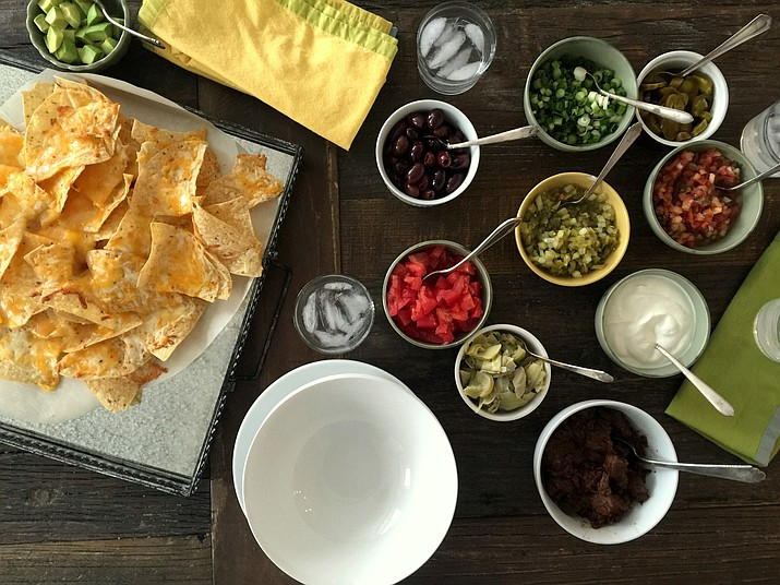 This undated photo shows a nacho bar on a table inside a home in New York. (Katie Workman via AP)