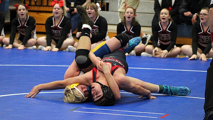 Kingman's Lucas Drummond, left, wrestles Lee Williams' Kobe Hales during their 195-pound bout Wednesday at KHS. Drummond won by pin in the third round.