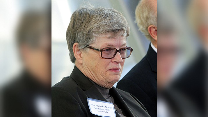 In this Nov. 9, 2012 file photo, Michigan State University President Lou Anna K. Simon attends an event in East Lansing, Mich. (AP Photo/Carlos Osorio, File)