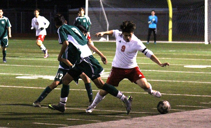 Mingus senior Eric Samano evades a couple Eagle defenders during the Marauders' 2-1 senior night win over Flagstaff on Tuesday. (VVN/James Kelley)