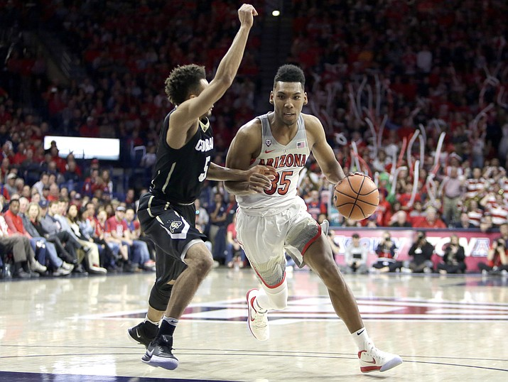 Arizona guard Allonzo Trier (35) drives on Colorado guard Deleon Brown in the second half during an NCAA college basketball game, Thursday, Jan. 25, 2018, in Tucson. Arizona defeated Colorado 80-71. (Rick Scuteri/AP)