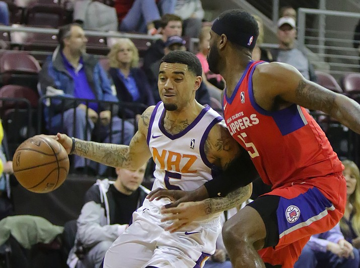 Northern Arizona's Josh Gray (5) dribbles past an Agua Caliente defender Friday, Jan. 26, 2018, in Prescott Valley. Gray led the Suns with a career-high 32 points in a 131-110 win over the Clippers. (Matt Hinshaw/NAZ Suns)