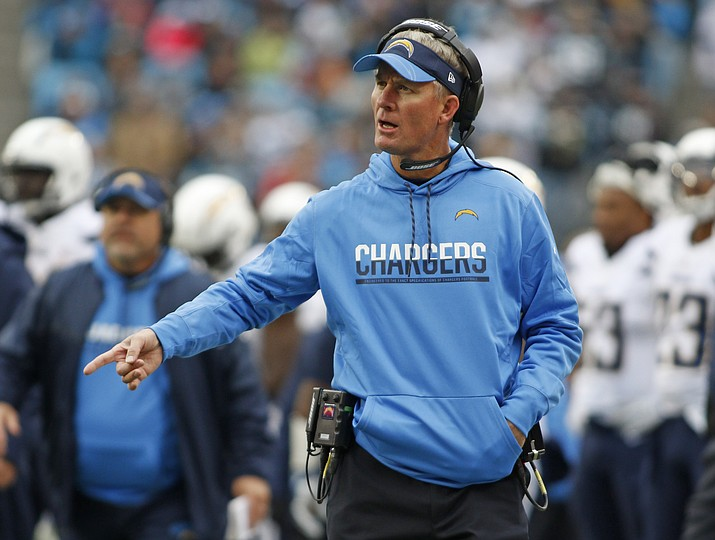 In this Dec. 11, 2016, file photo, San Diego Chargers coach Mike McCoy argues a call during the first half against the Carolina Panthers in Charlotte, N.C. McCoy has been hired as offensive coordinator by the Arizona Cardinals and Al Holcomb is following new Cardinals coach Steve Wilks from Carolina to be defensive coordinator. (Bob Leverone/AP, File)