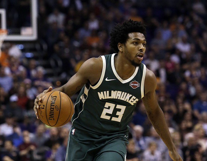 Milwaukee Bucks guard Sterling Brown (23) in the second half against the Phoenix Suns on Wednesday, Nov. 22, 2017, in Phoenix. Police officers used a stun gun on the rookie guard and arrested the 22-year-old Friday, Jan. 26, 2018, after a confrontation at a Walgreens parking lot in Milwaukee. (Rick Scuteri/File)