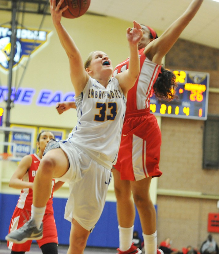 Embry-Riddle sophomore guard Jenna Knudson (33) converts a contested layup in the Eagles women's basketball team's eventual 72-56 Cal-Pac Conference-opening victory over Benedictine-Mesa Dec. 7 in Prescott. (Les Stukenberg/Courier, file)