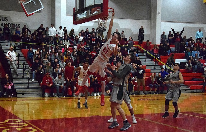 Mingus senior Alex Figy dunks during the Marauders' 56-47 win over Mohave at home on Thursday night. Figy scored 17 points. (VVN/James Kelley)