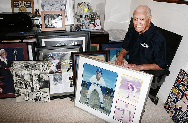 Former Los Angeles Dodgers great Maury Wills shows some of the memorabilia from his 14-year career in the major leagues. (Photo by Bill Helm)
