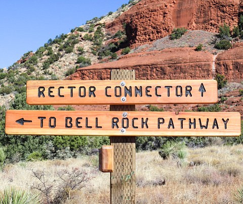 New Rector trailhead signage can be seen the south side of Bell Rock.