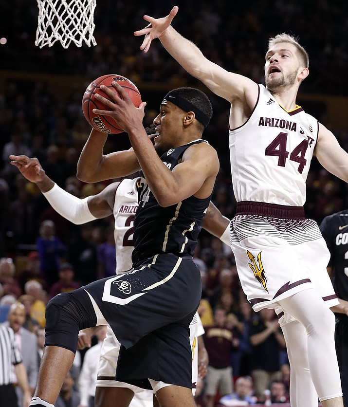 Colorado guard George King, front left, shoots under Arizona State guard Kodi Justice (44) during the first half of an NCAA college basketball game, Saturday, Jan. 27, 2018, in Tempe. (Matt York/AP)