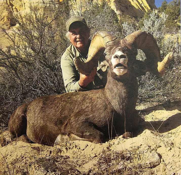Larry Altimus poses with the desert bighorn ram he killed illegally in southwestern Utah. Altimus paid a high price for the hunting violation. The prominent Arizona guide is banned from hunting in 47 states for the next 10 years and paid more than $30,000 in restitution and fines. (Utah Division of Wildlife Resources)