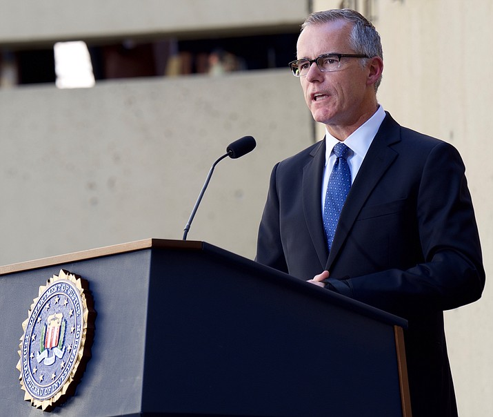 Deputy Director Andrew McCabe addresses the audience during Director Christopher Wray's formal installation ceremony at FBI Headquarters on September 28, 2017. Wray, a former U.S. attorney and assistant attorney general in the Justice Department's Criminal Division, was formally sworn in August 2, 2017 in a private ceremony.